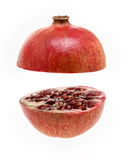 Pomegranate. Sliced into two on a white background stock images