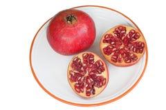 Pomegranate. Ripe pomegranates on a dessert plate Stock Image
