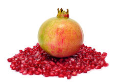 Pomegranate. A pomegranate fruit and arils isolated on a white background stock photo