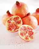 Pomegranate. Cut pomegranate in a group royalty free stock photo