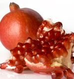 Pomegranate. On white background with slice on side Royalty Free Stock Photography