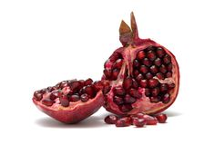 Pomegranate. On the white background royalty free stock photography