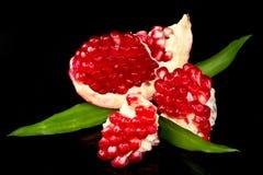 Pomegranate. Juicy pomegranate open on black background stock photo