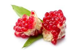 Pomegranate. Juicy pomegranate opened and isolated royalty free stock image