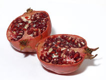 Pomegranate. Freshly sliced pomegranate isolated over white background Royalty Free Stock Images