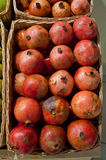 Pomegranate. Ripe pomegranates in a wattled basket Stock Photography