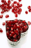 Pomegranate. Seed in a heart shaped jewelry box royalty free stock photography
