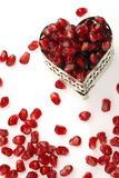 Pomegranate. Seed in a heart shaped jewelry box royalty free stock photos