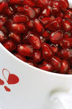 Pomegranate. Seed in a white cup with heart stock photography