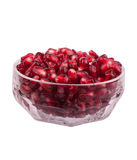 Pomegranate. Seeds in glass vase on a white background Royalty Free Stock Photos