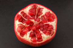 Pomegranate. Isolated on the black Stock Image