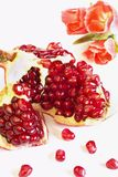 Pomegranate. Big juicy ripe fruit of pomegranate and its grains Stock Photography