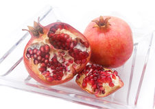 Pomegranate. On a glass plate Royalty Free Stock Photography
