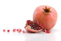 Pomegranate. Scattered grains of a pomegranate on a white background Royalty Free Stock Image