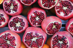Pomegranate. Alot of half pomegranate divided by two parts stock photos
