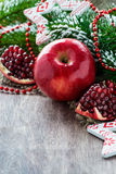 Pomegranate and apple with festive decorations Royalty Free Stock Photo