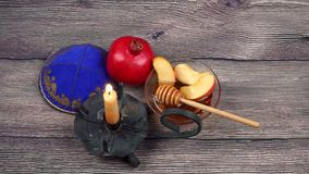 Pomegranate, apple and honey, traditional food of jewish New Year celebration, Rosh Hashana. Selective focus stock footage