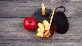 Pomegranate, apple and honey, traditional food of jewish New Year celebration, Rosh Hashana. Selective focus stock video