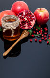 Pomegranate, apple and Honey for traditional holiday symbols Rosh hashanah royalty free stock photography
