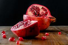 Pomegranate apple on wooden table stock photography