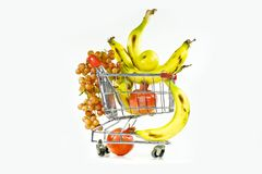 Pomegranate and apples in the carriage. Grapes, bananas and pomegranate in the carriage from a supermarket Royalty Free Stock Photography