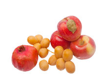 Pomegranate with apples and dates Royalty Free Stock Photo