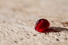 Pomegranate aril on wooden board Royalty Free Stock Images