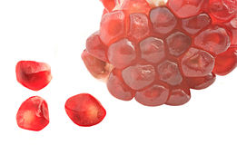 Pomegranate arils. Isolated on white background royalty free stock photo