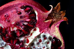 Pomegranate with arils detail shot stock photo