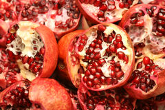 Pomegranate background. Background of delicious pomegranate halves stock photography