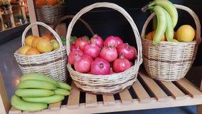 Pomegranate banana ananas basket fruits group autumn background. Pomegranate banana pineapple basket fruits group autumn background Royalty Free Stock Photos