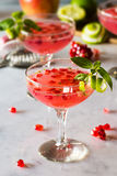 Pomegranate Basil Martini or Gin Smash Cocktail Stock Photography