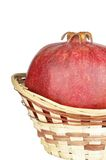 Pomegranate in the basket Stock Photos