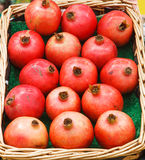 Pomegranate in basket Royalty Free Stock Images