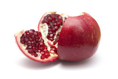 Pomegranate being broken into segments  isolated on white Royalty Free Stock Images