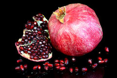Pomegranate on black. Stock Image