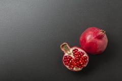 Pomegranate on black Stock Photo