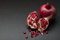 Pomegranate on black Stock Photography