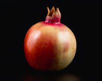 Pomegranate. On a Black background Royalty Free Stock Images