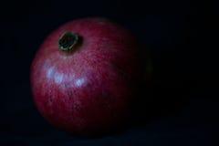 Pomegranate on black background Stock Images