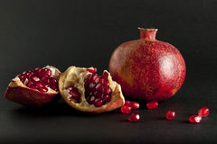 Pomegranate on black background Stock Image