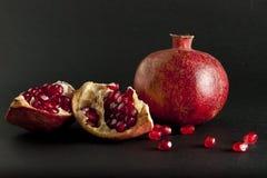 Pomegranate on black background Stock Image