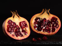 Pomegranate. With black background two half Royalty Free Stock Photo