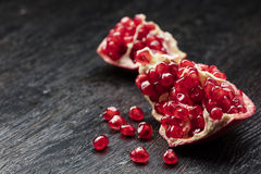 Pomegranate on black wood Royalty Free Stock Photos
