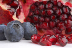 Pomegranate and blueberries Stock Photography