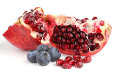Pomegranate and blueberries Royalty Free Stock Images
