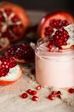 Pomegranate body cream on a wooden surface. Closeup royalty free stock photo