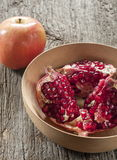 Pomegranate in bowl Stock Photography
