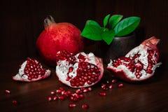Pomegranate with broken segments, still life Stock Image