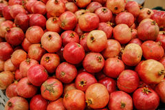 Pomegranate bulk. Fresh color vitamin red eating subtropical food juicy stock images